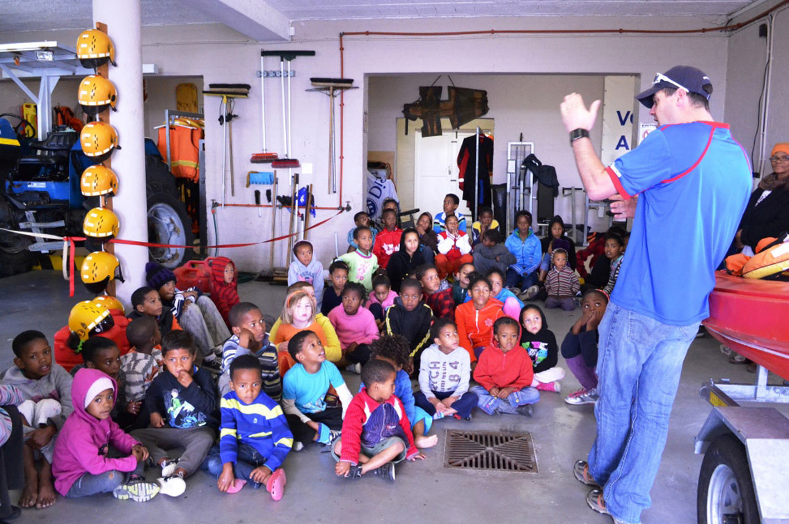 Bruce Sandmann talks to a group of children on a holiday programme at the Melkbosstrand NSRI station. Picture Daniel Bierman.