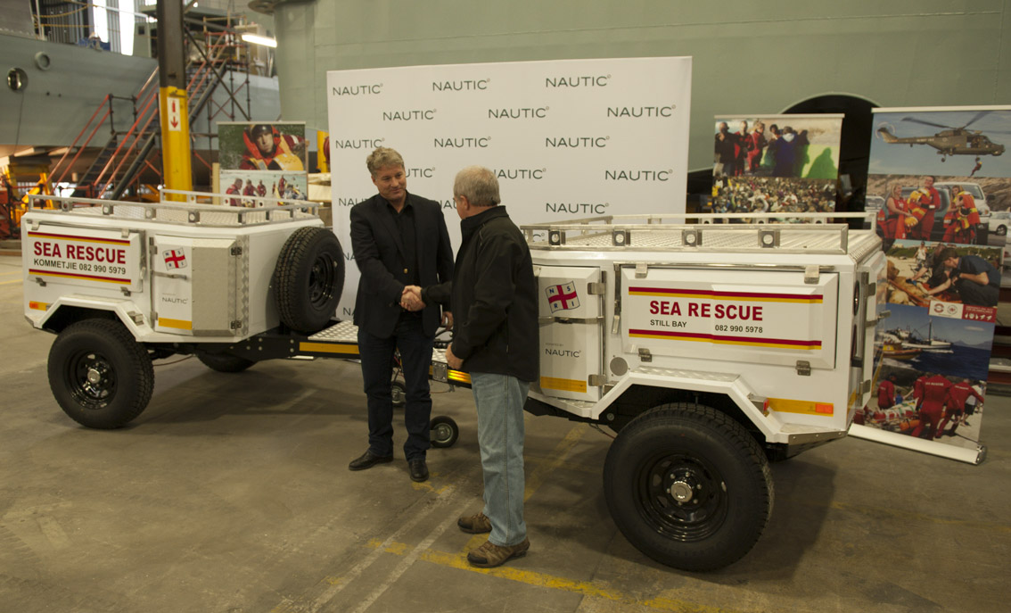 Nautic CEO James Fisher hands the trailers to NSRI's Mark Hughes.