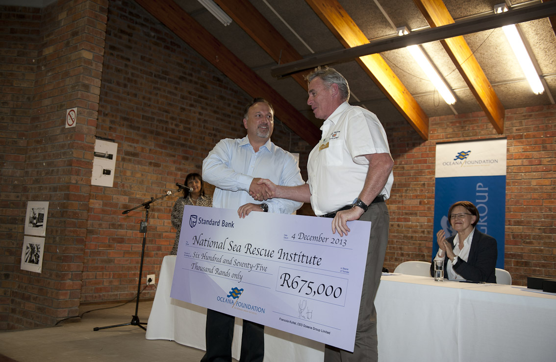 Francois Kuttel, Oceana Group CEO hands a symbolic cheque to NSRI CEO Cleeve Robertson.