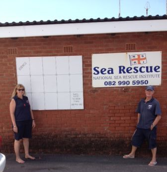 Station 20 crew members, Antoinette le Roux and John Rolt, with the advertising board shortly after it was erected by Mr Jan Barnard at the weekend.