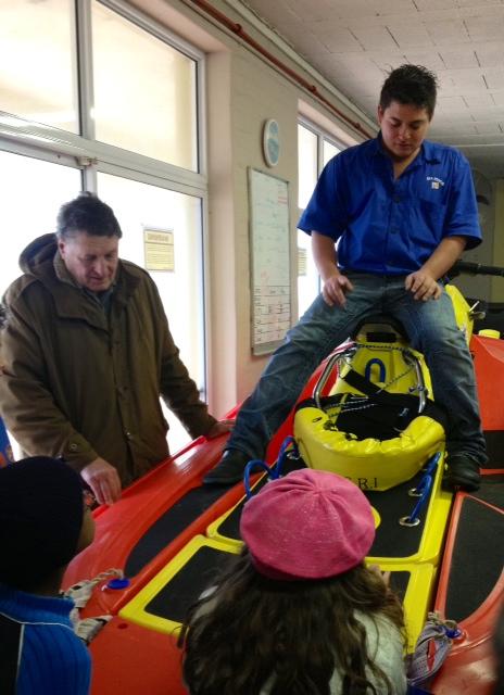 Daniel shows the children a rescue runner.