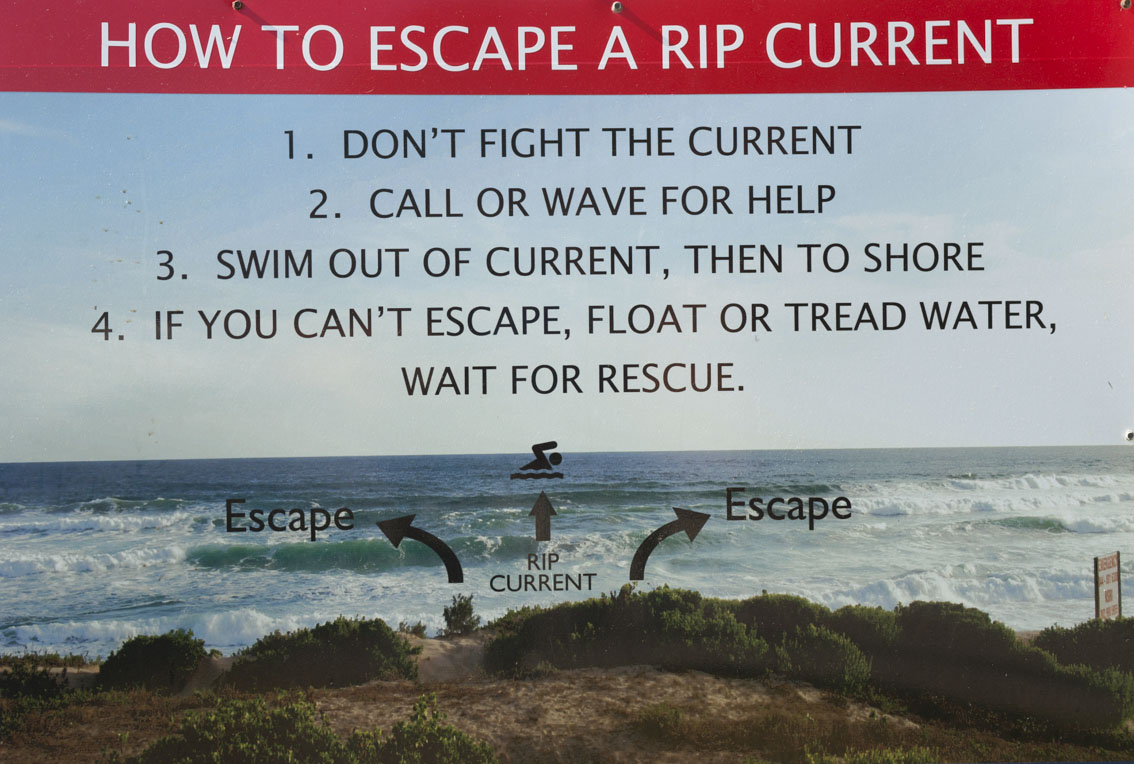 A sign at Swartvlei beach warns of the danger of rip currents.