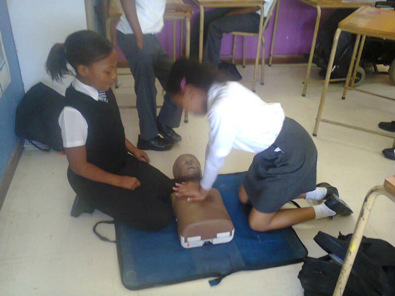 Sino(14) and Lelona(14) practising CPR.