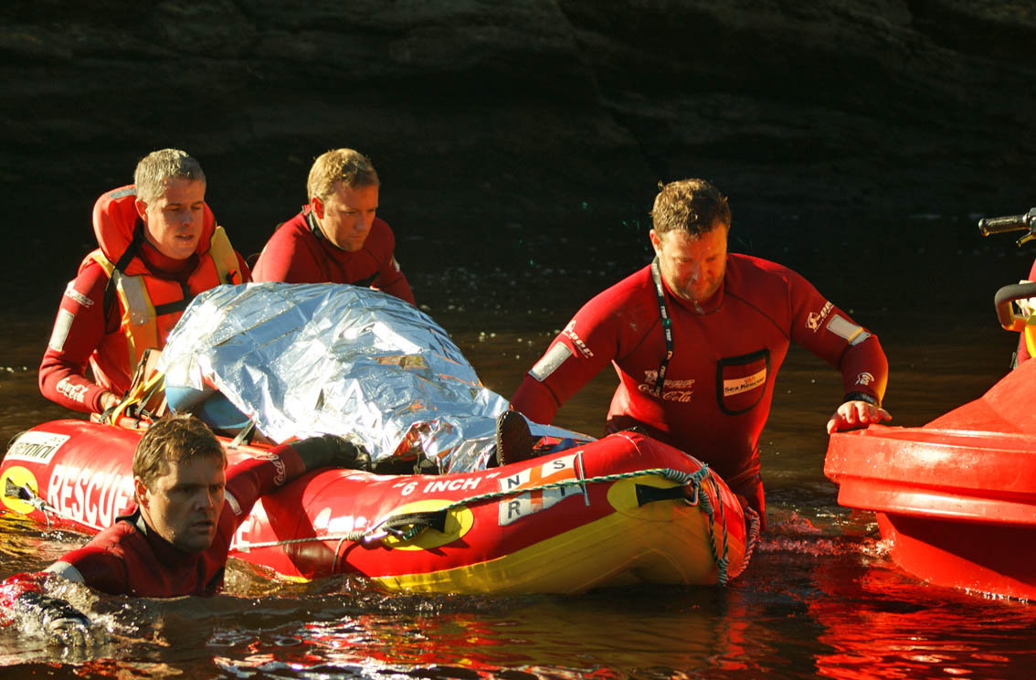 Wilderness NSRI volunteer swimmers Donald Olivier, Mike Vonk, Andrew Burrell and Jonathan Britton. Fortunately I can not be identified under the space blanket. Photo by Bianca Rautenbach