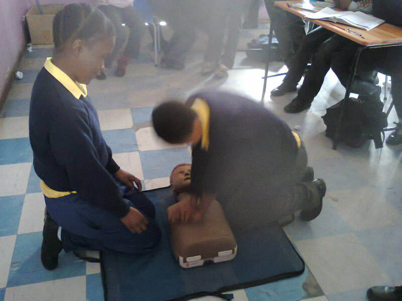 Pupils of Lehlohonlo Primary School practising for the first time CPR.